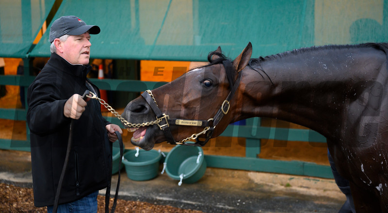 Trainer Mark Hennig holds Bourbon War for his bath after a preparatory gallop at the Pimlico Race Course Thursday May 16, 2019 in Baltimore,MD.  Photo by Skip Dickstein