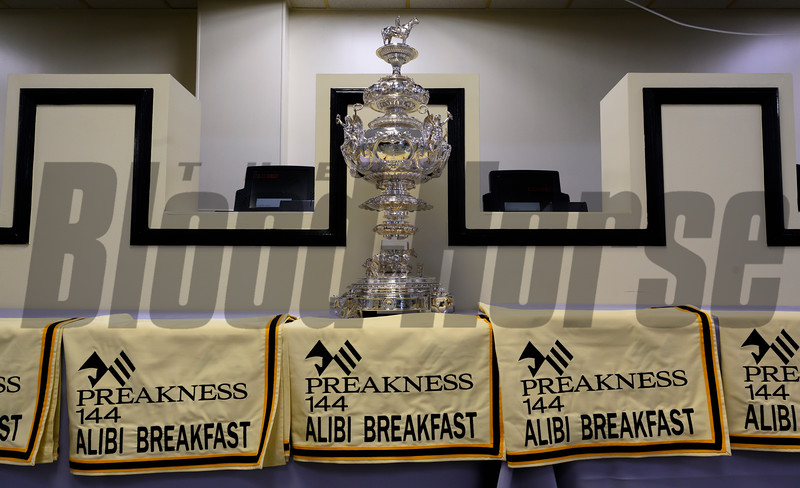 Saddle cloths are all lined up under the winner's trophy at the Alibi Breakfast at the Pimlico Race Course Thursday May 16, 2019 in Baltimore,MD.  Photo by Skip Dickstein