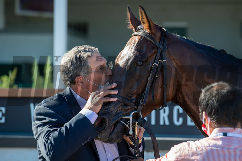 Neil Pessin kisses Bell's the One with Corey Lanerie after winning the Derby City Distaff (G1) at Churchill Downs, Louisville, KY on September 5, 2020.