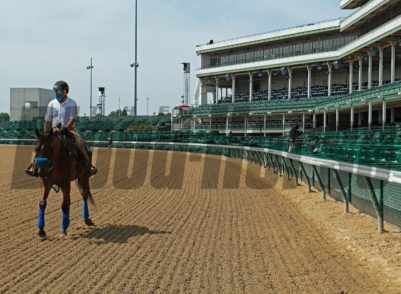 Outrider on way over to paddock/tunnel with empty grandstand seats behind. Scenes on Oaks day at Churchill Downs, Louisville, KY on September 3, 2020.