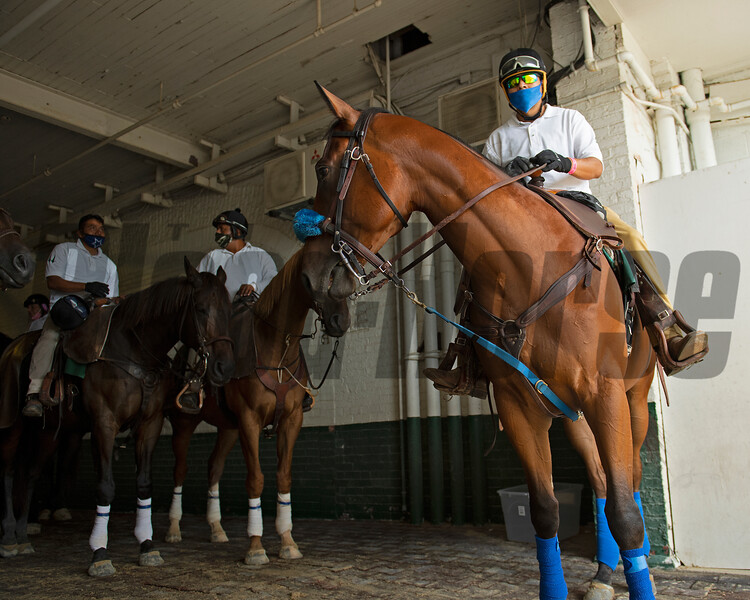 Outrider and ponies in tunnel. Scenes on Oaks day at Churchill Downs, Louisville, KY on September 3, 2020.