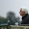 Trainer Bob Baffert keeps a close eye on his two charges  at the Pimlico Race Course Friday Oct 2, 2020 in preparation for Saturday's 145th Preakness Stakes.in Baltimore, MD.  Photo by Skip Dickstein