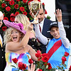 Jockey John R. Velazquez rider of Medina Spirit celebrates his fourth Kentucky Derby win with his wife Leona after winning the 1417th Kentucky Derby (G1) at Churchill Downs, Saturday, May 1, 2021 in Louisville, KY.  Photo by Skip Dickstein