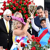 Jockey John R. Velazquez rider of Medina Spirit celebrates his fourth Kentucky Derby win with his wife Leona, Trainer Bob Baffert and Owner Amr Zedan after winning the 1417th Kentucky Derby (G1) at Churchill Downs, Saturday, May 1, 2021 in Louisville, KY.  Photo by Skip Dickstein