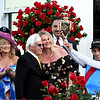 Jockey John R. Velazquez rider of Medina Spirit celebrates with the trophy after winning the 1417th Kentucky Derby (G1) as (L-R) wife Leona Velazquez, Trainer Bob Baffert and his wife Jill look on, at Churchill Downs, Saturday, May 1, 2021 in Louisville, KY.  Photo by Skip Dickstein