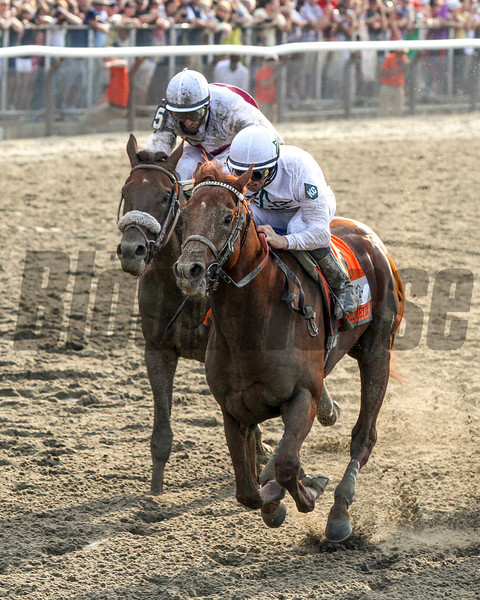 Drosselmeyer w/Mike Smith up leads Fly Down w/John Velazquez up to the wire to the win the 142nd Running of the Belmont Stakes at Belmont Park on June 5, 2010.<br /> Photo by: Chad Harmon
