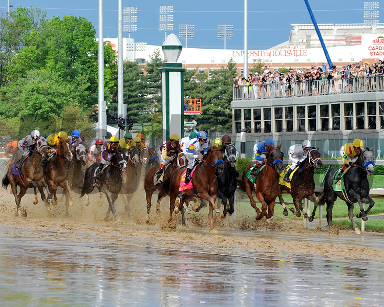 First time by in the 2010 Kentucky Derby, Conveyance leads the pack, with eventual winner Super Saver (#4) just behind on the rail. <br /> Dave W. Harmon Photo