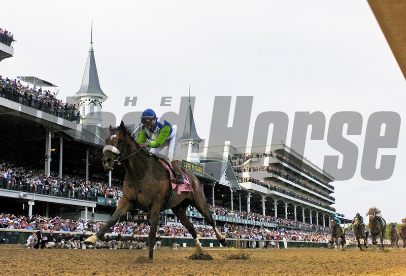 Jockey Edgar Prado runs under the famed spires to win the 132nd Running of the Kentucky Derby on Barbaro at Churchill Downs in Louisville, Kentucky May 6, 2006.  <br /> Photo by: Skip Dickstein