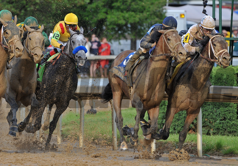 Calvin Borel, aboard Super Saver, battles with Noble's Promise as they turn for home in the 136th Kentucky Derby.