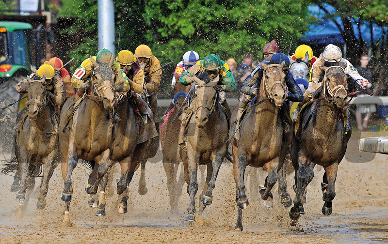 Super Saver turns for home in the 136th Kentucky Derby. Kentucky Derby Day 2010<br /> Photo by: Courtney Bearse