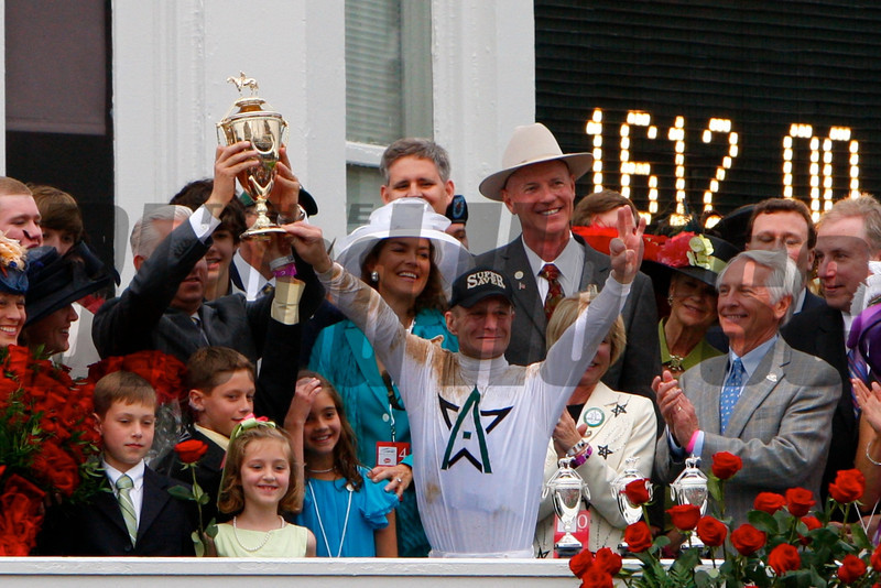 WInStar Farm owners Kenny Trout and BIll Casner, along with jockey Calvin Borel, celebrated winning the 136th running of the Kentucky Derby (G. I) at Churchill Downs in Louisville, KY on May 1, 2010.<br /> Photo by Crawford Ifland.