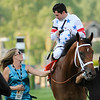 PHOTO BY SKIP DICKSTEIN - Jockey Kent Desormeaux speaks with assistant trainer Michele Nevins as Big Brown after winning  in the 133rd running of the Preakness Stakes at Pimlico Race Course in Baltimore, Maryland May 17, 2008.