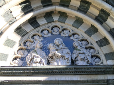 Cathedral of St. Stephen:  Detail of entryway, showing Madonna with Child and saints by Andrea della Robbia