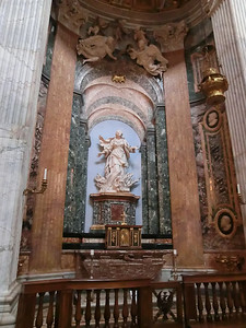 Sant'Agnese in Agone:  Statue of St. Agnes in the flames, E. Ferrara