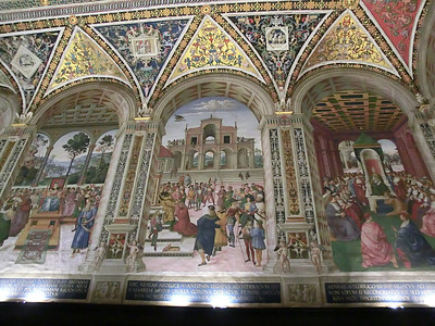 Duomo, Piccolomini Library, frescoes by Pinturicchio (16th C) showing scenes from the life of Aeneas Piccolomini (later Pope Pius II):  Left to right, Ambassador to Scotland, Crowning as Poet Laureate, Homage to Pope Eugenius IV