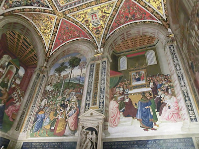 Duomo, Piccolomini Library, frescoes by Pinturicchio (16th C)  -- scenes from the life of Aeneas Piccolomini by Pinturicchio:  Piccolomini introduces Eleanor of Portugal to Frederick III (on the left) and elevation of Piccolomini to Cardinal