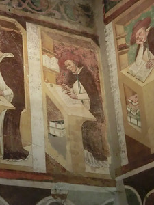Fresceo by Tommaso da Modena of working monk; refectory, church of San Nicolo; first known depiction of eyeglasses in Western art (1352)