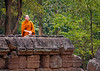 Cambodian Monk overlooking the temple ruins