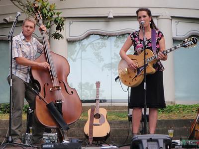 Sarah singing with husband Travis