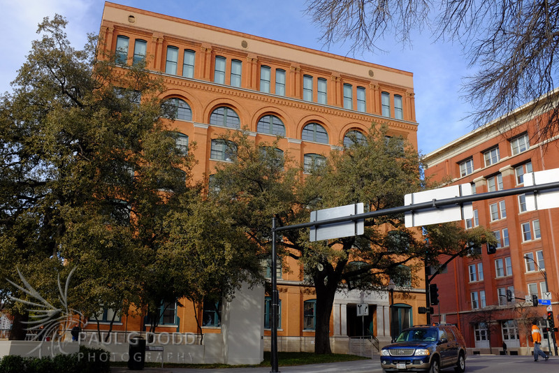 Texas Schoolbook Depository building showing the trajectory of the first shot.