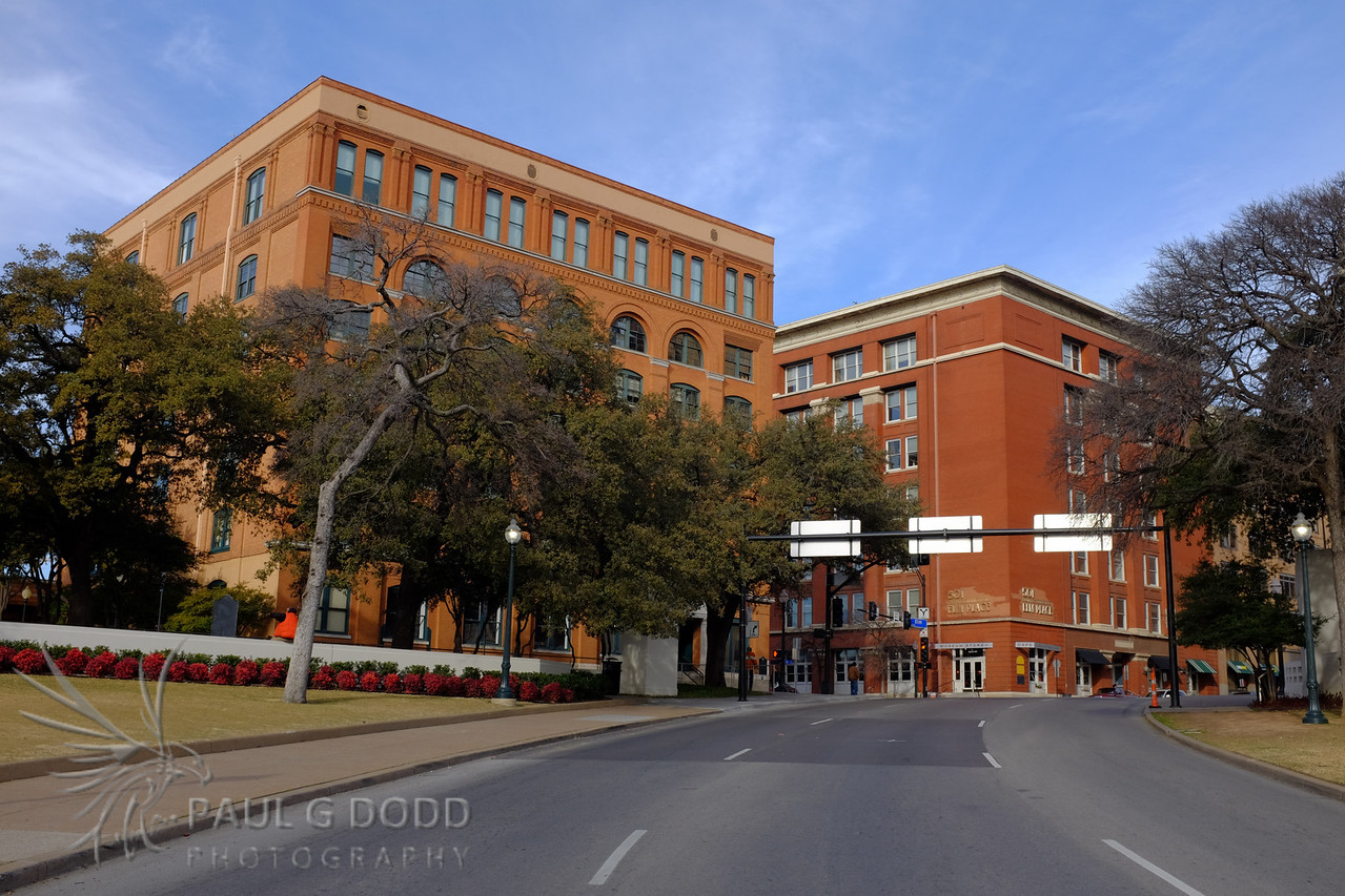 Texas Schoolbook Depository building showing the trajectory of the second shot.
