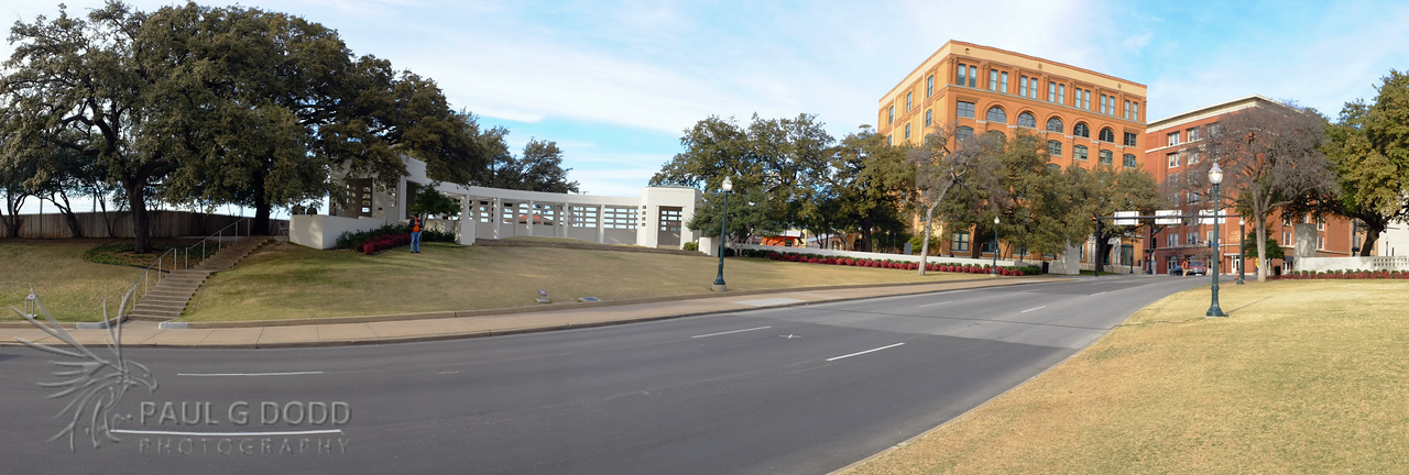 Dealey Plaza panorama showing the grassy knoll and the Texas Schoolbook Depository.