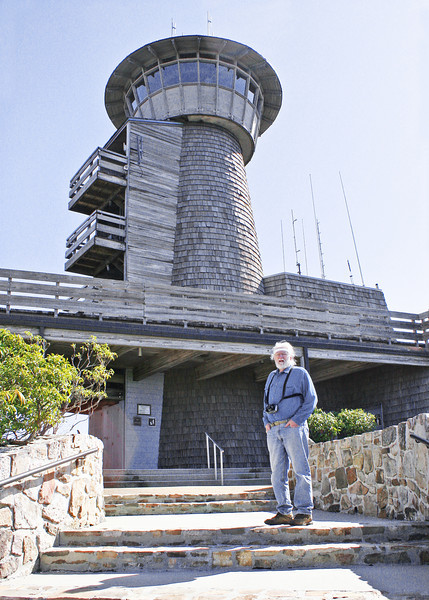 Mike at top with observation tower in background