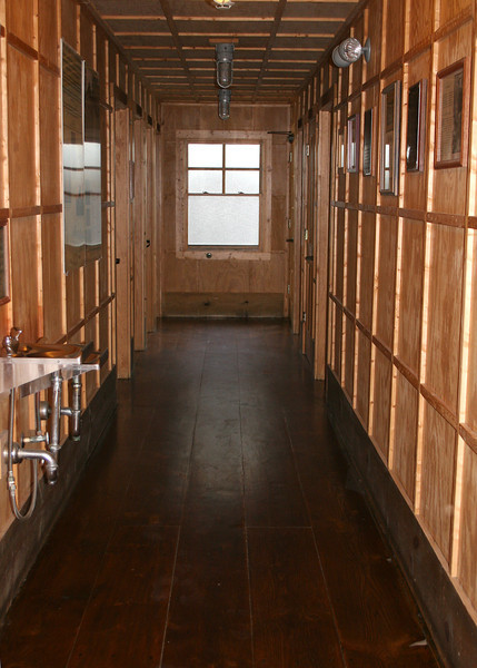 This is the hallway for the showers and toilets.  To the right are the women's showers and the left are the men's.  At the end of the hall are the toilets.