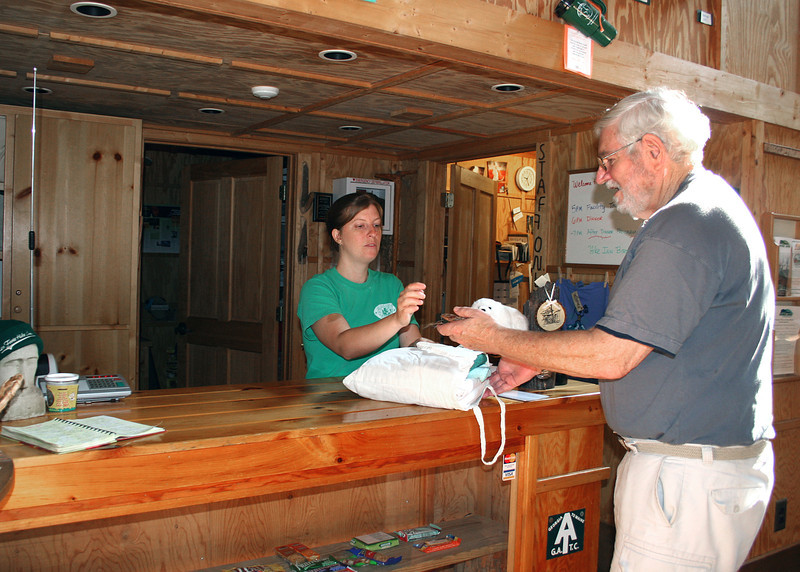 Mike checking into Len Foote Hike Inn.  Each guest is given a bag that contains sheets, pillow case, towel and wash cloth.  Each guest makes their own bed and then strips it when they leave, putting the dirty linens and towels in the bag and depositing it in a container outside the lobby.