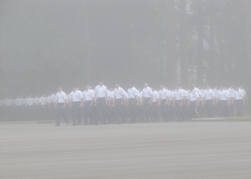 Ft. Benning - The troops marching in through the morning fog.  It was very mystical as the music played the these young men appeared out of the fog.