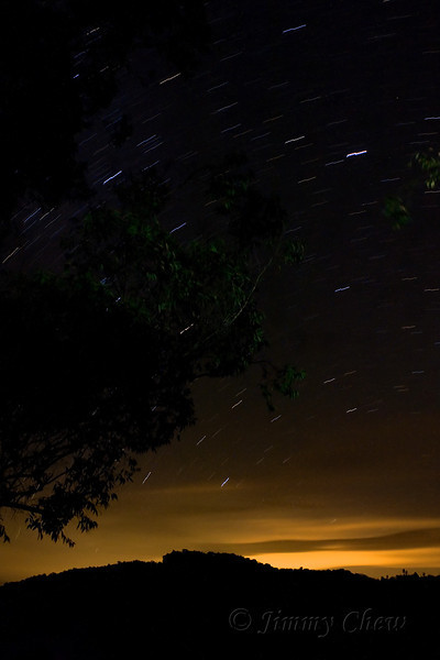 Night shot of star trails. Walking on the verandah caused vibrations, so the star trails appear jagged.