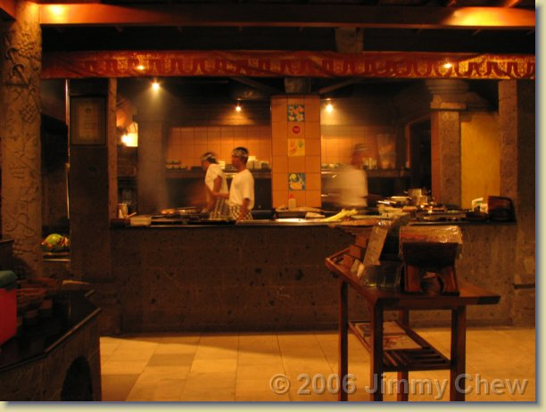 "The open kitchen. They greet ""selamat datang"" to alll who enters into Bumbu Bali. Everyone already inside will then look."