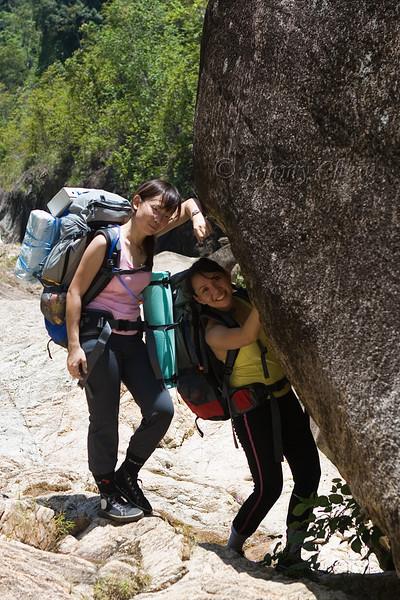 Joyce and Melissa. Melissa pushing the boulder.