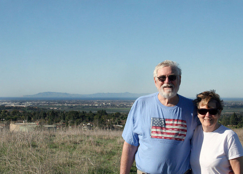 Mike and Susan with the Pacific Ocean in the background