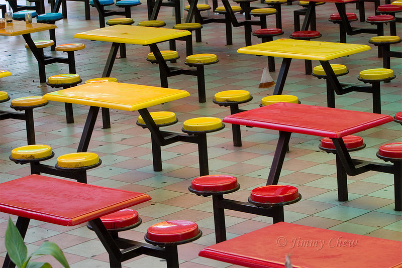 Static tables and chairs in an open restaurant in Brinchang.