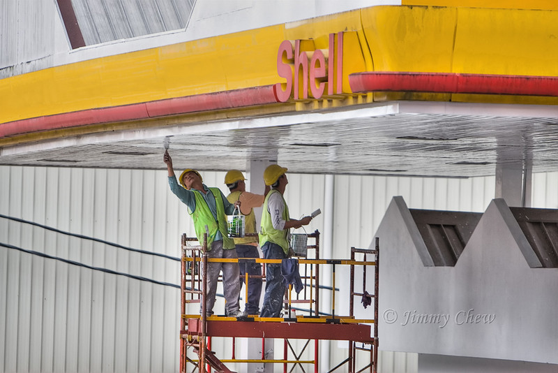 Workers re-painting the petrol station.