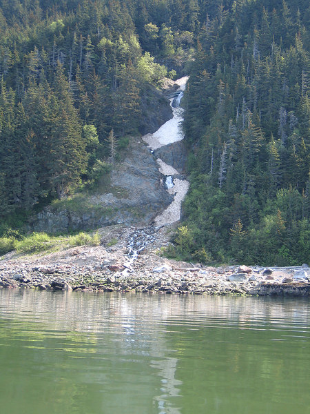 Another beautiful waterfall rushing into the green water of Lynn Canal