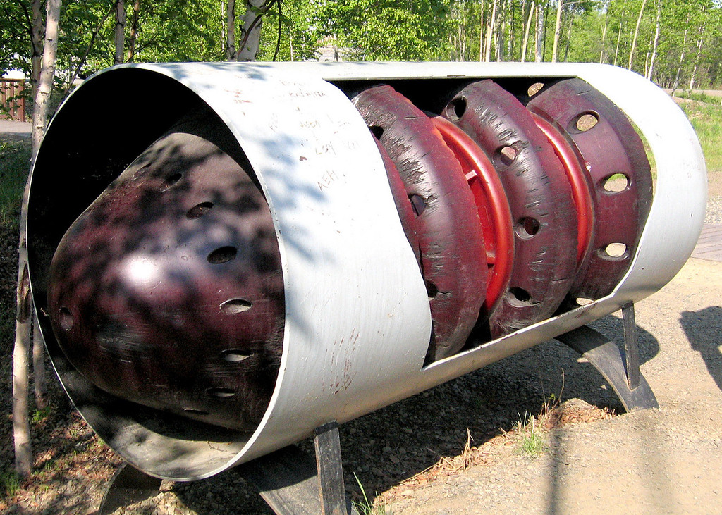 "This shows how one of the ""pigs"" fits into the pipe.  Pig is an acronym for ""pipeline inspection gauges"".  This improves the flow of oil through the pipeline and monitors its condition.  Pigs are launched and retrieved at pump stations and travel through the pipeline with the moving oil.  The orange polyurethane sample here is a cleaning and flow improvement pig.  Other more sophisticated pigs use magnetic fields and ultrasonic signals to detect small changes in the pipe's wall thickness and shape.  Pigs are among the most important tools available for protecting the pipeline and detecting potential problems."