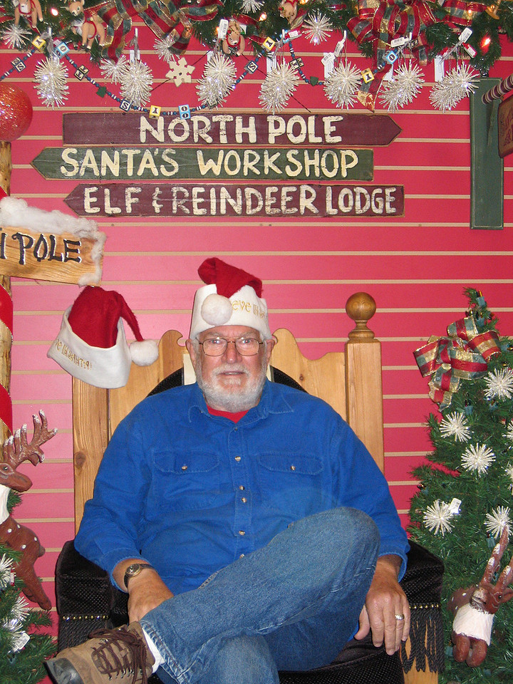 Mike sitting in Santa's chair at Santa Claus House, North Pole, AK
