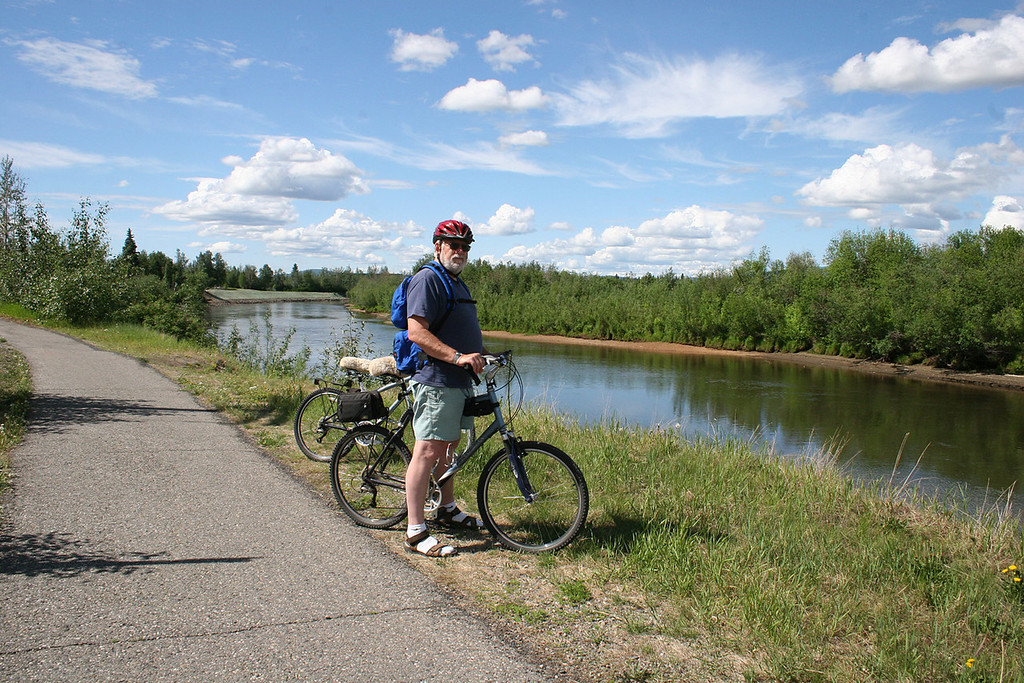 Mike biking on bike path along the Chena River