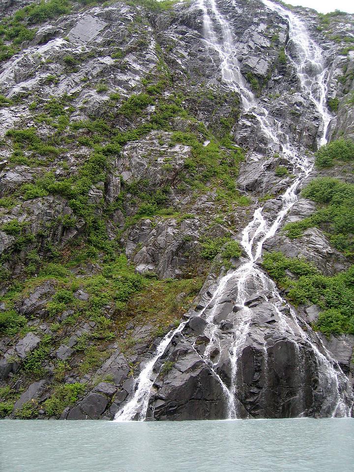 Waterfalls spilling into Portage Lake