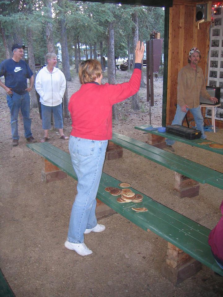 Susan tossing a pancake