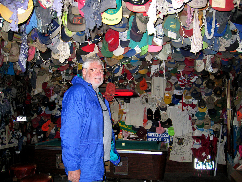 Mike at the Chicken Creek Saloon.  Look at all the hats and other objects on the ceiling and walls.