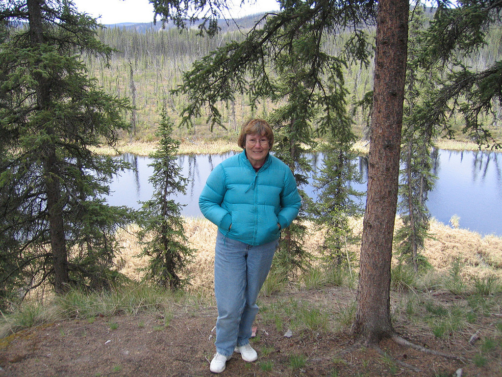 Susan  with Johna's Lake in background at West Fork Campground about 15 miles from Chicken, AK