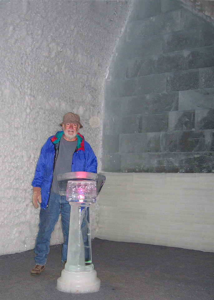 Mike at podium in the Aurora Ice Hotel Museum