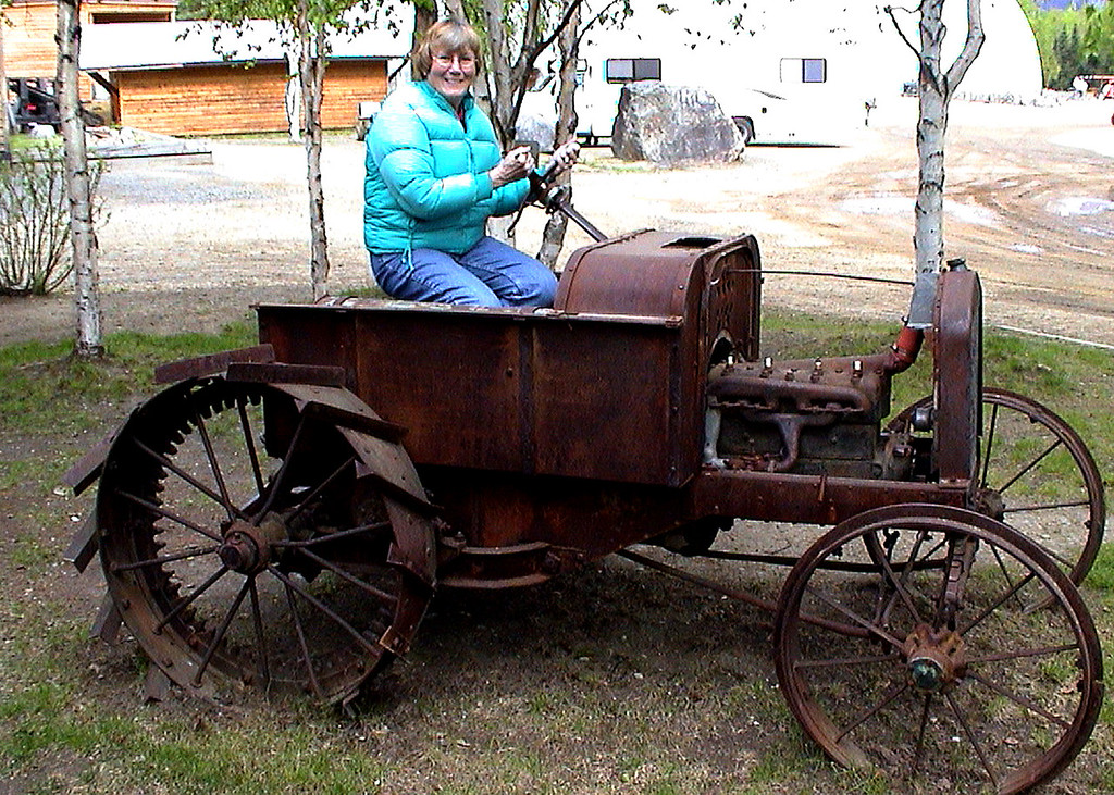 Susan on old tractor at Chena Hot Springs