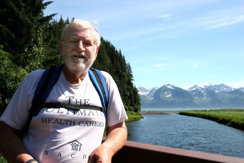 Mike on bridge over Tonsina River at Tonsina Point, Seward, AK with Resurrection Bay in background