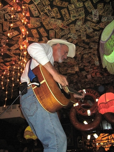 Hobo Jim playing from the top of a table, Yukon Bar, Seward, AK
