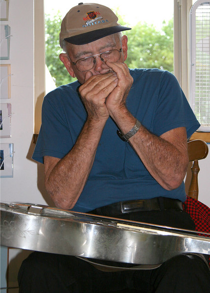 Jim Kaufman playing the harmonica