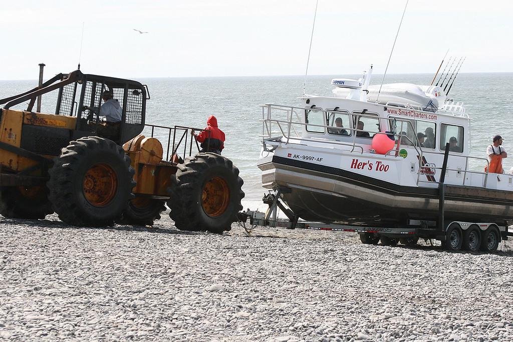 Bringing in boat at beach in Ninilchik